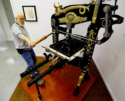 Ted Leigh demonstrates the Columbian Press at the Museum of Printing